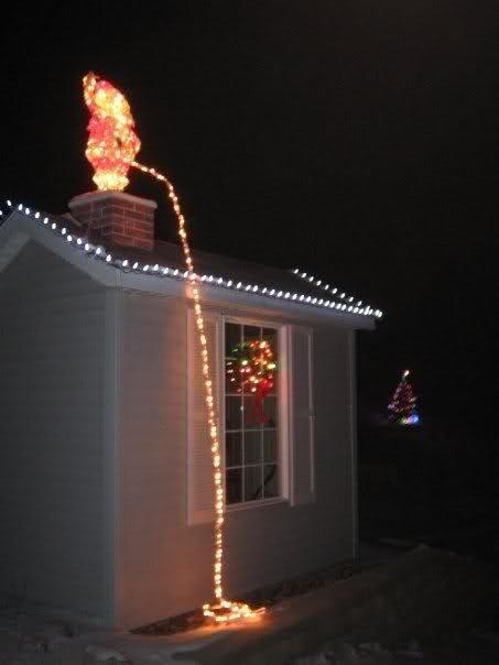 Pissing Santa. . piss pissing Santa xmass lol chrismass lights house Snow funny