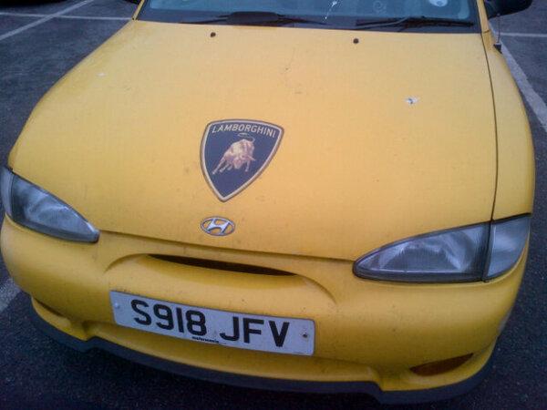 Lamborghini prototype?. Seen this car posing as a Lamborghini in a car park... must belong to the same guy that owns this Ferrari MR2 fail car Cars Lamborghini Yellow Carpark Hyundai epic